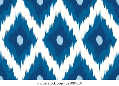 Seamless pattern Tribal Art Ikat Ogee in traditional classic blue and white colors. Boho style. Vector illustration