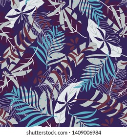 Seamless pattern with tropical leaves on a dark background. Vector design. Jungle print. Floral background.