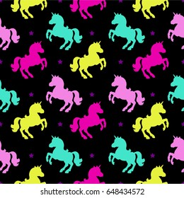 Seamless pattern with unicorn silhouette. Vector illustration. Cute magic background. Fantasy wallpaper