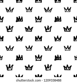 Seamless pattern with various crowns isolated on white background. Rough brush painted shapes. Ink street-style abstract grunge illustration.
