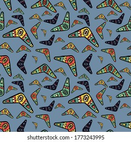Seamless pattern vector of tribal motif art style boomerang on tribal pastel background for making many kinds of artwork, printing or textile
