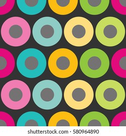 Seamless pattern with a vintage and retro look created by colorful circles. Nice pattern design for women's clothing or wall decoration. Easy to print on fabric or paper. Stock vector.