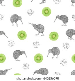 Seamless pattern with watercolor kiwi birds and kiwi fruit slices.