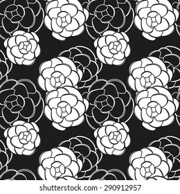 Seamless pattern or white camellia flowers on a black background