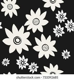 Seamless pattern White flowers on a black background. For your design. Vector.