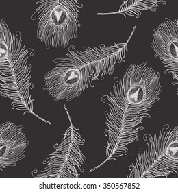 Seamless pattern with white hand drawn feathers on dark background. Seamless texture with peacock feathers in ethnic boho style. Vintage print perfect for home textile or fall fashion