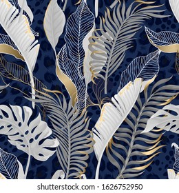 Seamless pattern with white tropical  leaves with gold elements on  blue leopard background.
