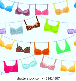 Seamless pattern with women's lingerie hanging at rope . Bra and bustiers. Women's clothing. Vector illustration