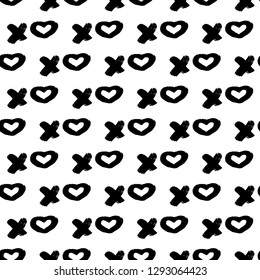 Seamless pattern XOXO with hearts on white background. Hugs and kisses abbreviation symbol. Grunge hand written brush lettering XO. Easy to edit template for Valentine's day. Vector illustration.