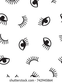 Seamless patterns with winking eyes and eyelashes. In black and white.