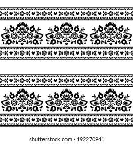 Seamless Polish black folk pattern with flowers on white