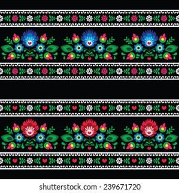 Seamless Polish folk art pattern with flowers - wzory lowickie on black