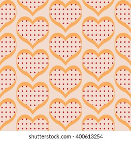 Seamless polka dot hearts pattern background for use in the textile printing and design packages