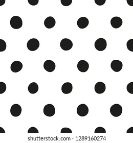 Seamless polka dot pattern of black dots on white background