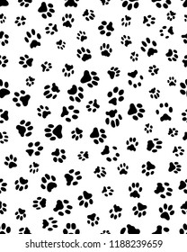 Seamless prints of paws of dog on a white background