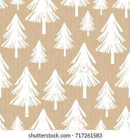 Seamless repeat pattern with hand drawn Christmas trees in white on craft paper background.