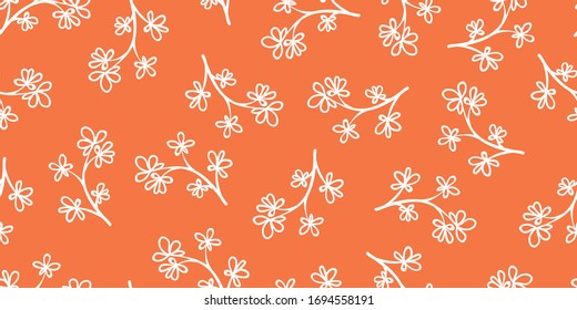 Seamless repeat pattern of a white floral branch on bright orange background. This random toss repeat is a lovely ditzy pattern for decorative designs, papers and home decor projects.