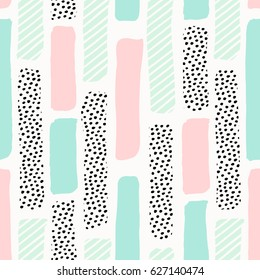 Seamless repeating pattern with brush strokes in pastel pink, mint green and dots texture on white background. Creative and modern tiling background, poster, textile, greeting card design.