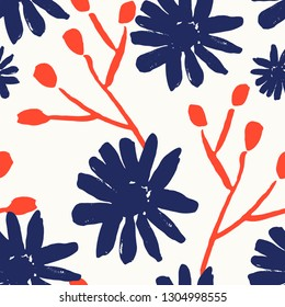 Seamless repeating pattern with hand painted flower blossoms and branches in red, blue and white. Hand drawn vector illustration, perfect for fabrics, greeting cards, wrapping paper, packaging.