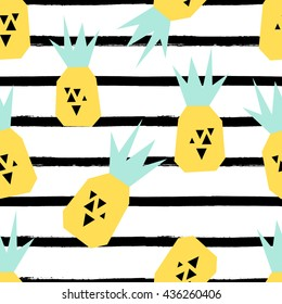Seamless repeating pattern with pineapples on black and white stripes background. Modern textile, greeting card, poster, wrapping paper designs.
