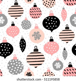 Seamless repeating pattern with textured Christmas baubles in black, pastel pink and gray on white background. Modern and original festive textile, gift wrap, wall art design.