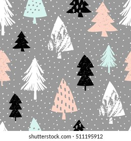 Seamless repeating pattern with textured Christmas trees in black, pastel pink, light blue and white on gray background. Modern and original festive textile, gift wrap, wall art design.