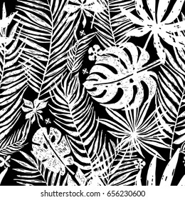 Seamless repeating pattern with white silhouettes of palm tree leaves in black background. Vector botanical illustration, elements for design.
