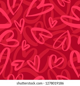 Seamless romantic pattern with hand drawn red hearts. Colorful doodle hearts on red background. Ready template for design, postcards, print, poster, party, Valentine's day, vintage textile. Vector.