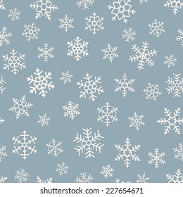 Seamless simple pattern of different  geometric snowflakes on blue background