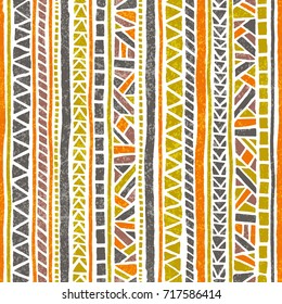 Seamless striped pattern. Ethnic and tribal motifs. Vintage print, grunge texture.Simple ornament. Handmade. Orange, green, gray and white colors. Vector illustration.