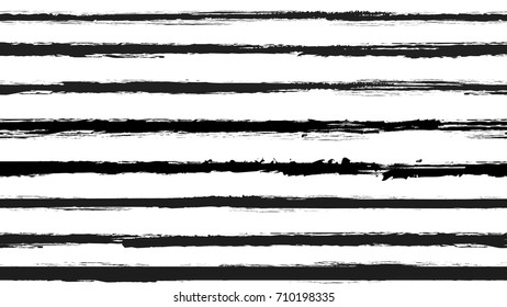 Seamless striped pattern. Horizontal line with torn paper effect. Ethnic background. Monochrome, white and black. EPS10 vector illustration. Texture for backdrop. Retro paint brush stroke stripes.