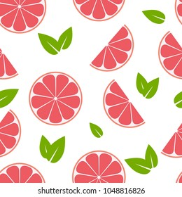 Seamless summer pattern with grapefruit slices and leaves. Vector texture illustration.