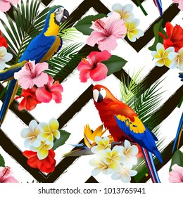 Seamless summer tropical background with tropical flowers and colorful parrots. Vector illustration.