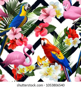 Seamless summer tropical background with tropical flowers and colorful parrots, with pink flamingo Vector illustration.