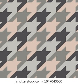 Seamless surface pattern design with houndstooth ornament. Classic fashion fabric print. Mosaic motif. Checkered geometric abstract background. Digital paper, textile print, page fill. Vector art.