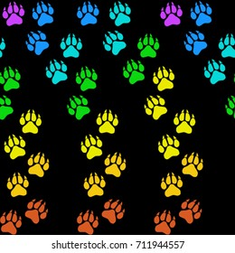 Seamless texture. Colored traces of paws on a black background