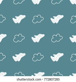 Seamless travel background made with white hand drawn airplanes and clouds