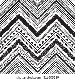 Seamless tribal zigzag pattern background that is hand-drawn with markers. Aztec creative illustration.