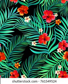 Seamless tropical pattern with hibiscus, palm leaves and flowers. Vector illustration. ESP10.