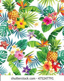 Seamless tropical pattern with pineapples, palm leaves and flowers. Vector illustration.