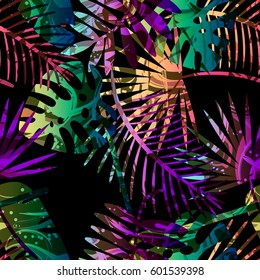 Seamless tropical vector pattern with tropical plants and palm leaves. Fashion jungle print for design.