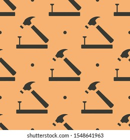 Seamless two color dark slate gray hammer nail wood outline flat pattern on light salmon background.