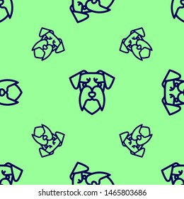 Seamless two color midnight blue miniature schnauzer flat pattern on pale green background.