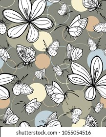 Seamless vector background with butterflies and crocus flowers