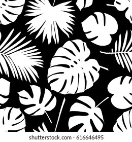 Seamless vector background with decorative leaves. Palm leaves.