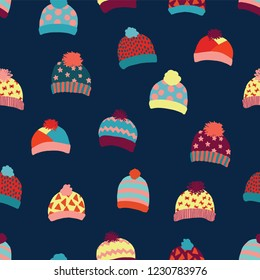 Seamless vector background knitted wool hats. Warm winter clothes wear pattern. Hand drawn cozy and warm accessories. Scandinavian Winter wear. Norwegian knit fashion. For kids, fabric, paper, decor