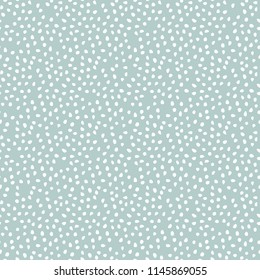 Seamless vector background with random elements. Abstract ornament. Dotted abstract light blue and white pattern