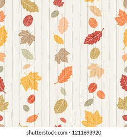 Seamless Vector Bright Autumn Falling Leaves Stripes on Shiplap Wood Plank Background. Great for holidays, Thanksgiving, invitations, stationery, greeting cards, fabric, paper crafting, & home decor.