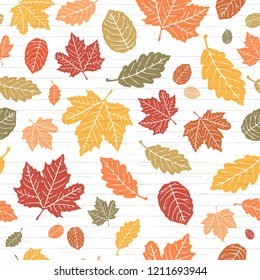 Seamless Vector Bright Colored Autumn Falling Leaves on Shiplap Wood Plank Background. Great for holidays, Thanksgiving, invitations, stationery, greeting cards, fabric, paper crafting, & home decor.