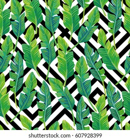 Seamless vector composition of tropical palm leaves on a black and white geometric background. Beautiful beach wallpaper
